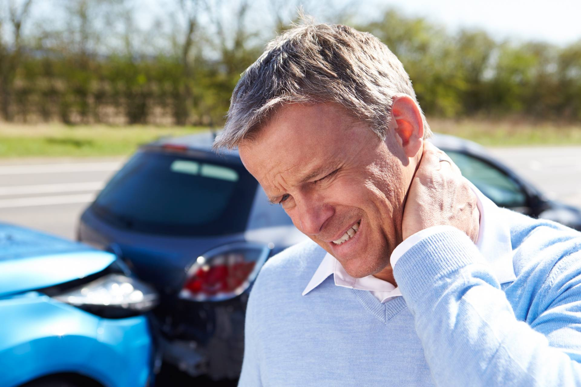 Man holds neck after an auto accident injury in Jefferson, GA